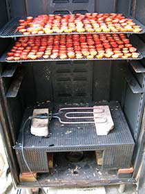 Drying tomatoes in a smokehouse.
