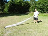 The net is long. When thrown, it opens to 14 foot diameter.