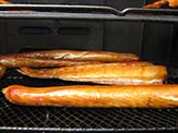 Pellicle in smoked fish. The unsmoked fish will have a greyish shine and the smoked fish will exhibit a golden gloss.