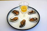 Smoked oysters with clarified lemon butter.