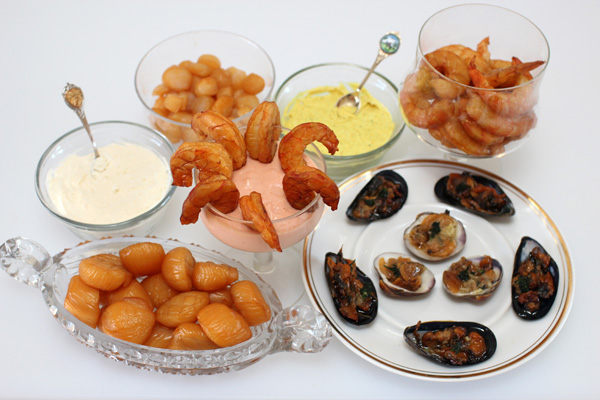 Smoked clams, mussels, shrimp and scallops with cocktail sauce and ...