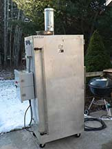 The snow is on the ground, but this insulated smokehouse can maintain high temperatures in any conditions.