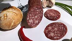 Salchichón is a large diameter and quite long dry sausage, usually stuffed into pork bung or suitable artificial casings.