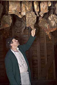hams in smokehouse