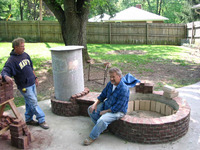 Laying firebricks inside fire pit
