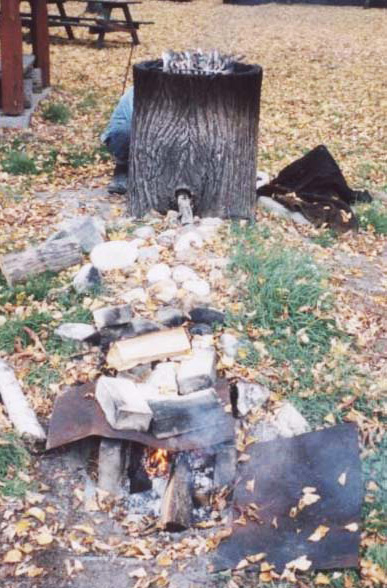 Tree stump meat smoker